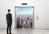 Elevator Pitch - Man Looking Out To City