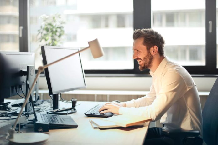 man sitting at desk with unified communications